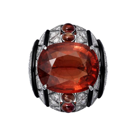 L'Odyssée de Cartier Parcours d'un Style 'Africa' high jewelry ring in Platinum, one 24.14-carat cushion-shaped brown tourmaline, cabochon-cut orange sapphires, onyx, brilliants.