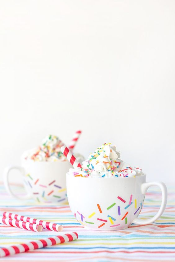 DIY Sprinkle Mugs - don't have a circut but could try this with multicoloured sharpies & bake for longer lasting finish