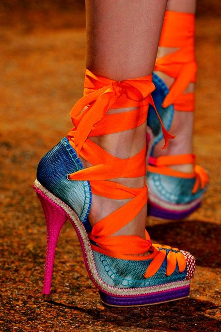 in some crazy way, i lovee these high heels? haha :P blue velvet pumps with pink heels and orange laces