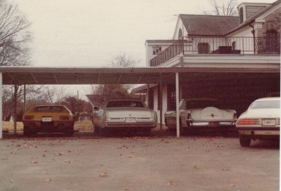Some of Elvis's cars behind Graceland 12/74 Photo by Sandi Pichon