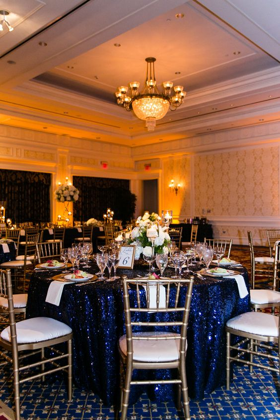 Blue White And Gold Wedding Decor : Round tables low centerpieces and gold chairs on