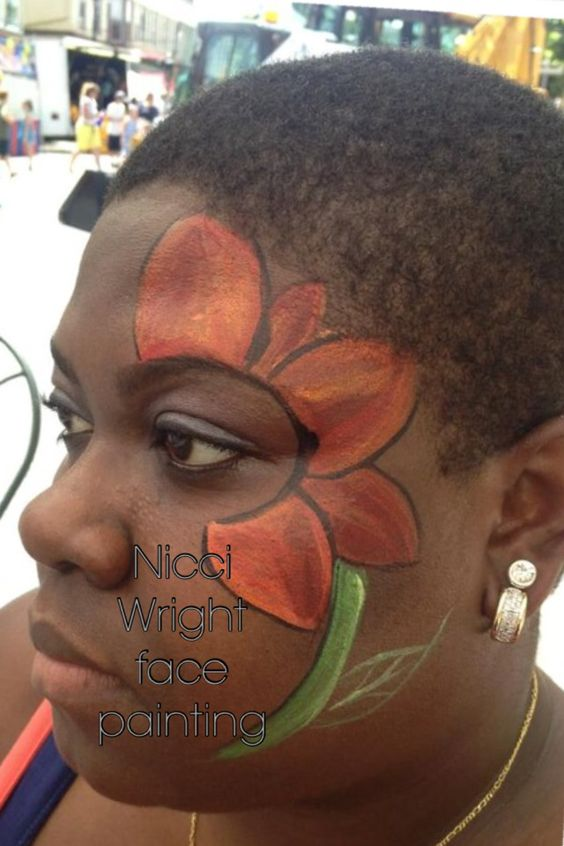 Flower Face painting by Nicci Wright