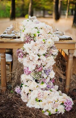 K'Mich Weddings- Wedding planning - centerpiece alternatives - SHEfinds - What a great alternative to table runners - a cascading floral runner!
