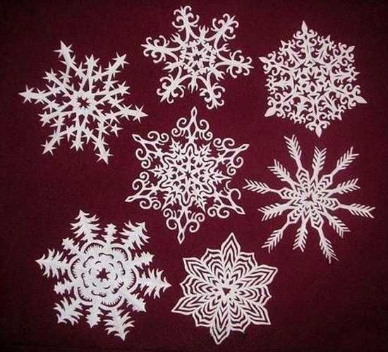 Making paper snowflakes and garlands charming handmade for Christmas paper crafts for adults