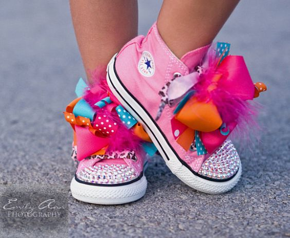 Im obsessed with these. Easy to make too! Shoes+ rhinestones+glue. Funky laces or Ribbon. 2 funky hair bows. Easy to change up.