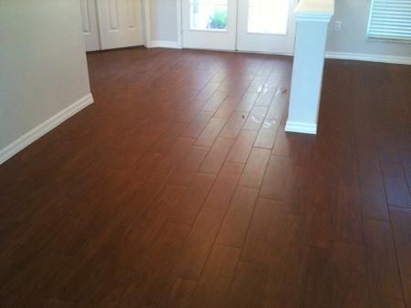 Tile that looks like wood why didn 39 t i know about this for Why laminate flooring