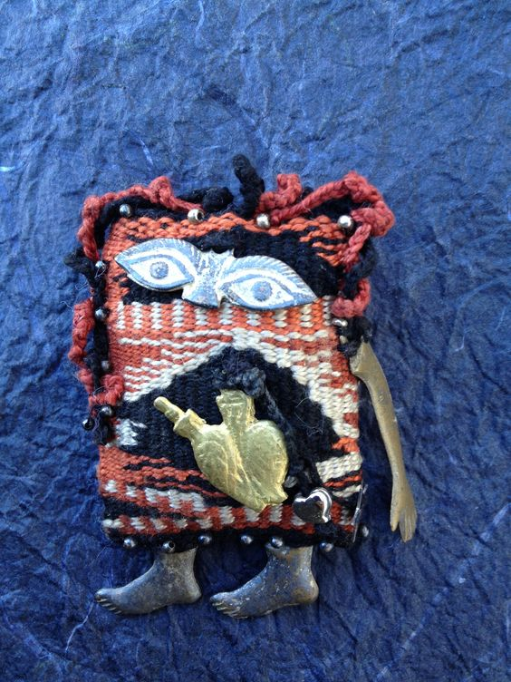 """Milagro Baby,"" pin by Gail Gagnon Garcia, handwoven fabric, charms, silver beads. G3 was a Redlands, CA, artist who died about 9 years ago. Miss you, Gail.:"