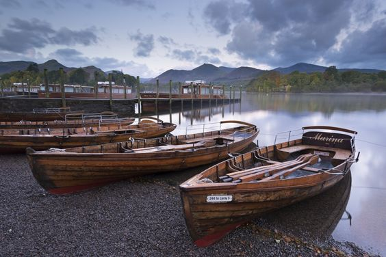Rowing boats on the shores of Derwent Water near Keswick in the Lake District…