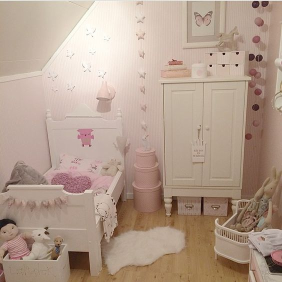 Cute room. I like how bright and light all the white makes it.