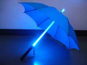 UM.. I want a LIGHT SABER umbrella!!
