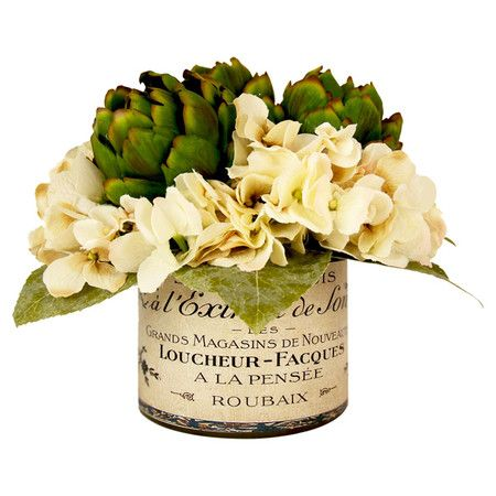 Create a lush tablescape or charming vignette with this lovely faux hydrangea and artichoke arrangement, showcasing vibrant blossoms and verdant greenery nes...: