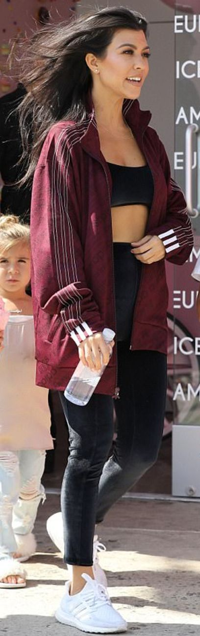 Who made  Kourtney Kardashian's white sneakers and red striped jacket?