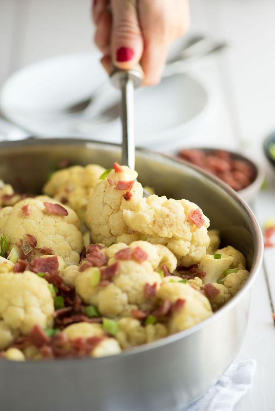 Loaded Cauliflower Mac and Cheese is a delicious guilt free take on a classic ! Cauliflower tossed in a vegan, paleo cheese sauce and topped with crispy bacon.