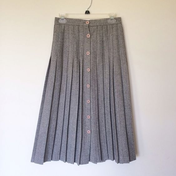 Vintage wool pleated skirt Wool pleated skirt with buttons in the front. Made in US. Size 8 but more like a small for today. Waist is 14 inches. Length is 32 inches. From smoke free and pet free home. Excellent vintage condition. Skirts Midi