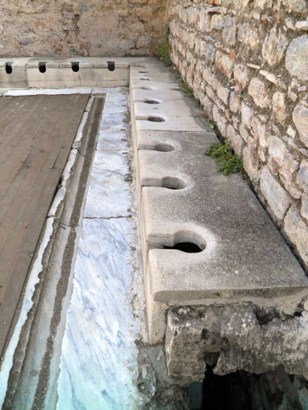 Latrine at Ephesus, (Turkey). They were part of the Scholastica Baths and built in the 1C AD. They were the public toilets of the city. There was an entrance fee to use them. © Carole Raddato:
