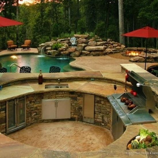 Amazing backyard!!a girl can dream. The layout is seriously so perfect and practical. Waterfall into Pool, firepit, outdoor kitchen grill island:
