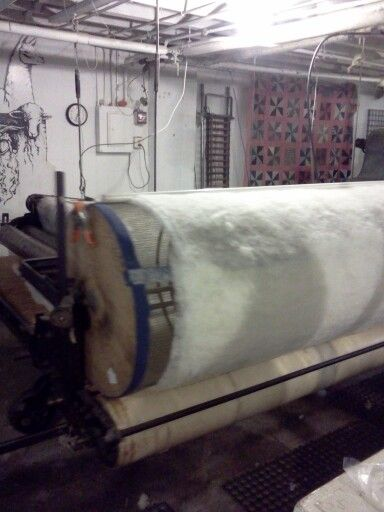 Fifth stage of batting machine.  Rolling of wool