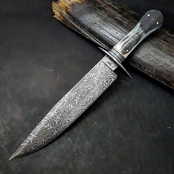 "10"" Snowflake Damascus with Firestorm edge, ladder pattern Damascus guard, crushed W's Damascus spacer and twisted Damascus frame engraved stainless finial and some of the prettiest ancient mammoth ivory I have seen. Now for the sheath. I think black Alligator."