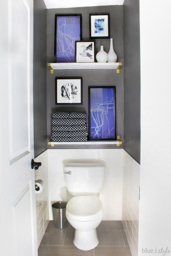 Water closets don't have to be boring. Take the focus off the toilet with tile, (faux) marble shelves, and art. This entire graphic glam bathroom makeover is a must see.:
