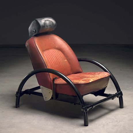 Ron Arad chair design. Rusted and used chair from Fordism (mass production). Remade with round metal poles as legs for chair.