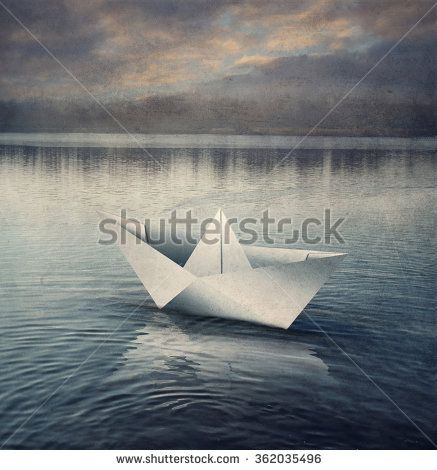 Origami paper sailboat in vintage style.  Retro, old poster filtered.