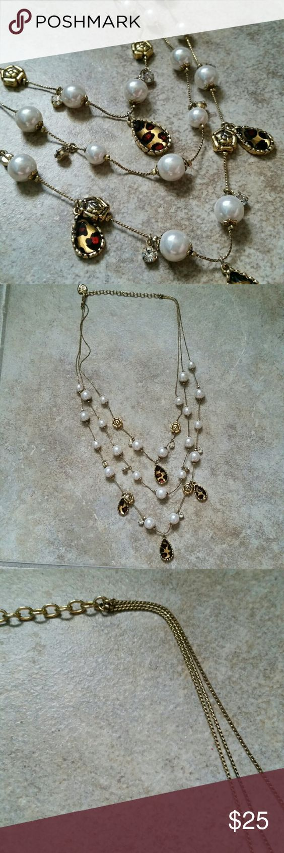 *NEW* BETSEY JOHNSON 3-tiered layered necklace This Betsey Johnson beauty is a three tiered layered necklace with pearls, rhinestones, and leopard print tear drop stones. Very lightweight, has a gold adjustable chain, and is a fabulous staple piece. Betsey Johnson Jewelry Necklaces