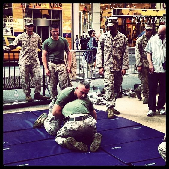 Wrestling army men in Times Square, New York, NY #nyc #timessquare #wrestling #wrestlers #fleetweek #armedforces #navy #marines #army #sailor #soldier - @arnab11- #webstagram