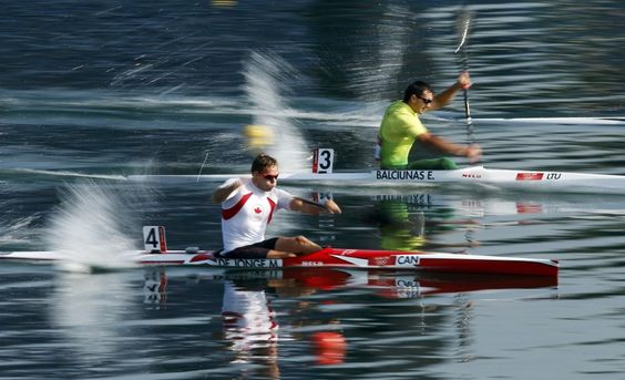 Canada's Mark de Jonge (L) and Lithuania's Egidijus Balciunas compete in the men's kayak single (K1) 200m heat at the Eton Dorney during the London 2012 Olympic Games August 10, 2012.