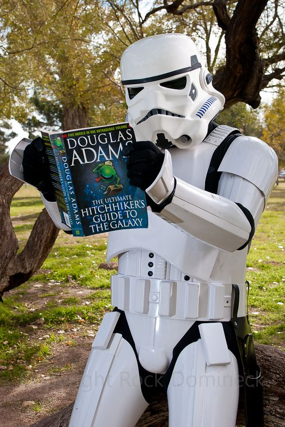 Unidentified stormtrooper reads Douglas Adam's The Hitchhiker's Guide to the Galaxy. --Stacy