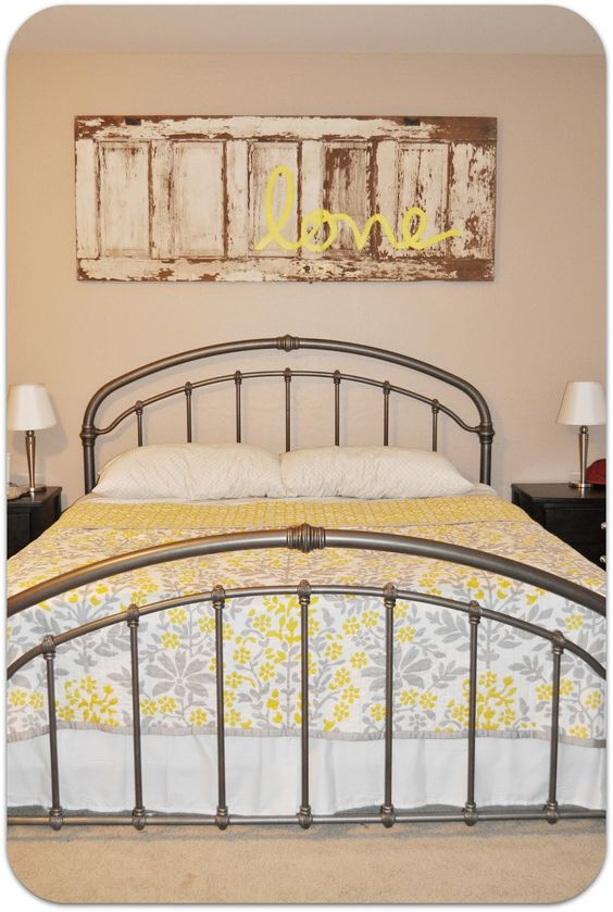 An old door as decor above the bed with a simple word on it. It would make a great headboard idea too!