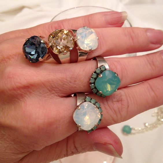 Statement Swarovski rings...add a touch of sparkle to your outfit! Love the denim blue, pacific green opal and white opal.