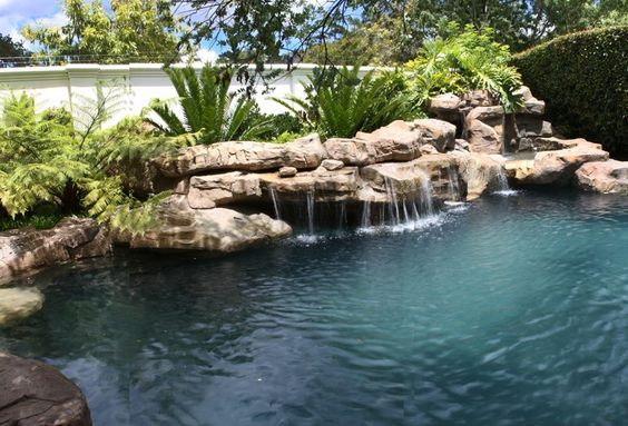 Rock pool with beautiful streaming waterfalls grotto and for Beautiful swimming pools with waterfalls