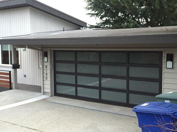 Modern look and frosted glass garage door. Glass gates and Garage Doors - https://www.pinterest.com/avivbeber3/glass-gates-and-garage-doors/