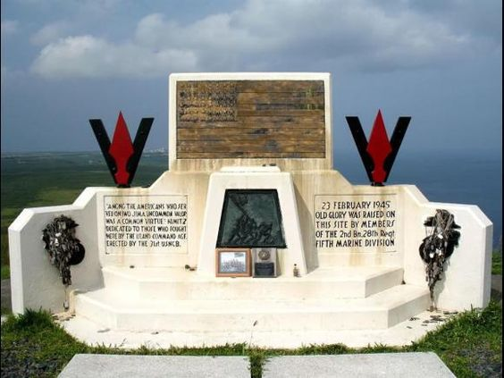 This monument was erected on the spot where Franklin Sousley, Harlon Block, Michael Strank, John Bradley, Rene Gagnon, and Ira Hayes raised the American flag four days into the Battle for Iwo Jima.  Visiting Marines leave personal mementos behind during their 'pilgrimages'. The Eagle, Globe and Anchors on the left and right side of the monument are completely covered in dog tags left by visiting Marines and service men to honor the 6,821 killed. Remember what they did.