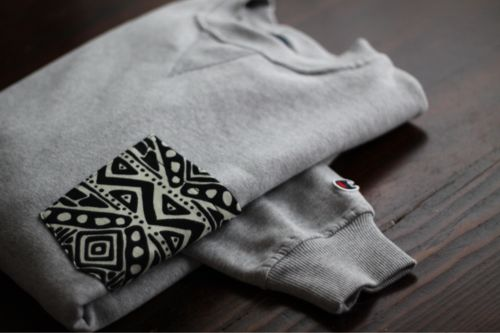 Buy a Hanes sweatshirt & create a pocket in a pattern.