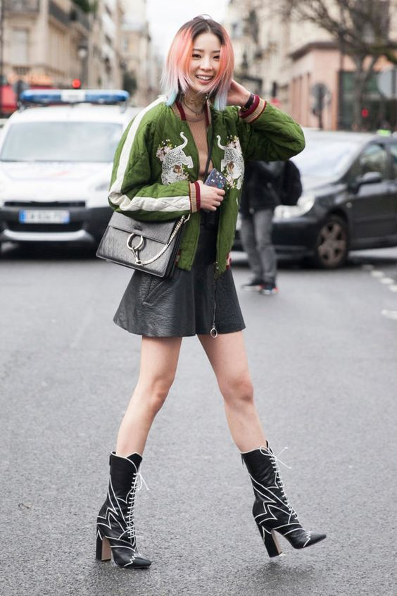 Irene Kim in Miu Miu boots and Chloe jacket at Paris Fashion Week. Photo: Emily Malan/Fashionista: