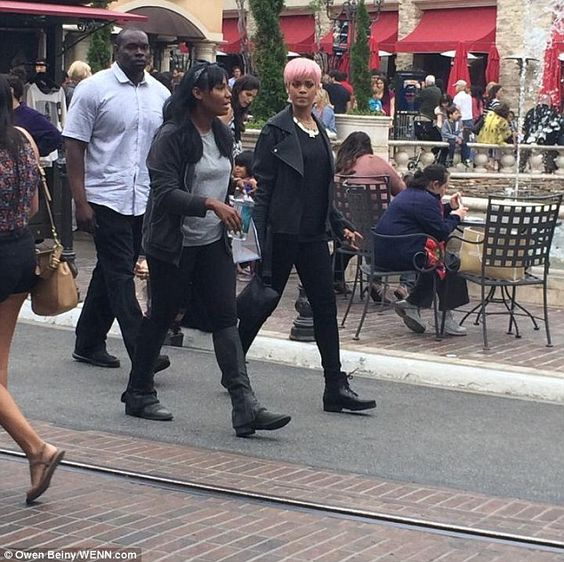 shopping with a friend at The Grove outdoor mall in Los Angeles on Sunday with a bodyguard in tow