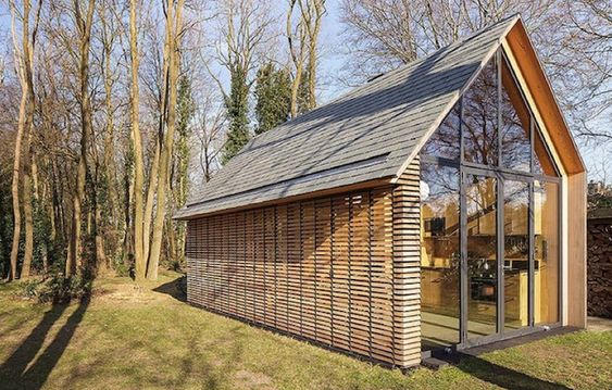 This tiny Dutch garden house was turned into a gorgeous shutter-clad getaway