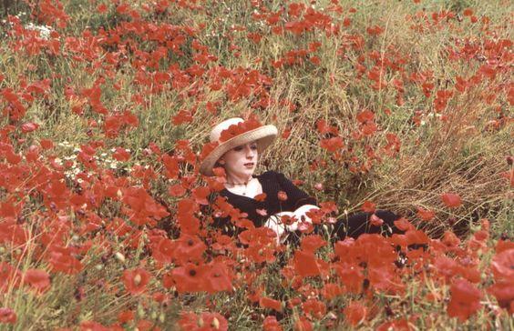 Charlotte in poppy field