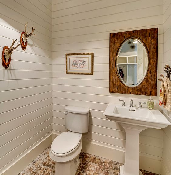 White-Painted Bathroom Siding. Accent Wood Mirror. Brick Paver Floor. Bannister Custom Homes.:
