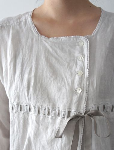 [an asymmetrical closure may be possible to alter a scoop neckline (maybe even cut up the front and finish the edges)]