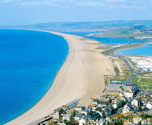 Chesil Beach, Dorset, UK.  Both the beach and the lagoon are important areas for wildlife with a number of national and international designations to help protect this important area. The area lies at the centre of the Jurassic Coast, a UNESCO designated World Heritage Site. The approximately estimated travel/road distance from Shaftesbury to Chesil Beach is around 37.16 miles to 40.39 miles