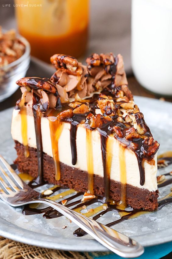 This Turtle Brownie Cheesecake has a brownie bottom, caramel cheesecake and lots of pecans, caramel and chocolate sauce! It's a delicious combination of flavors and textures that's perfect for fall! Turtle candies are definitely one of my faves. I love pretty much anything with caramel and turtles do not lack in that department one bit. …