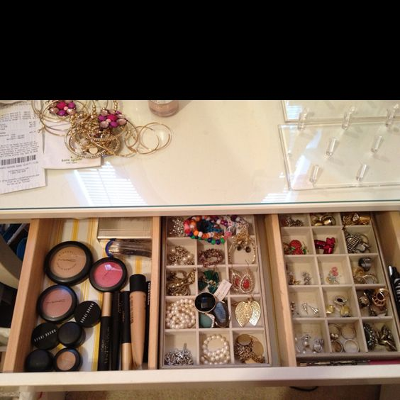 The inside drawer of my vanity..where I keep my everyday makeup, rings, studs, and some bracelets. To save room and to be practical I put the rest of my makeup that I don't need on a daily basis in my sephora train case that sits under my vanity.