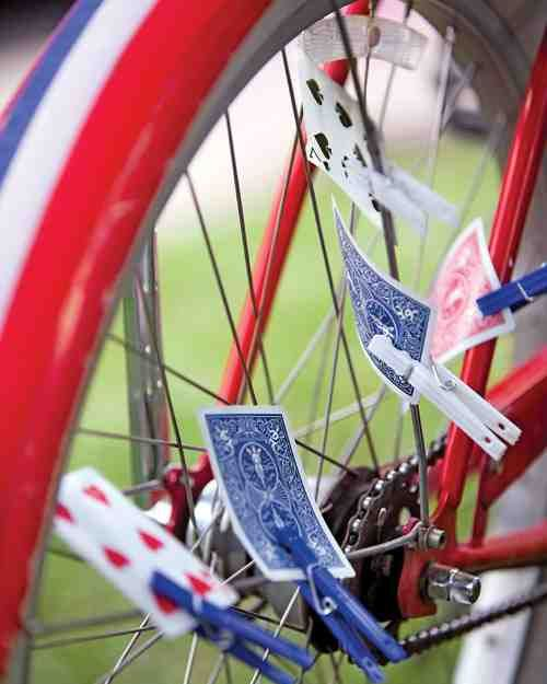 In the Cards  Fasten playing cards to bike spokes with clothespins and make a ruckus!