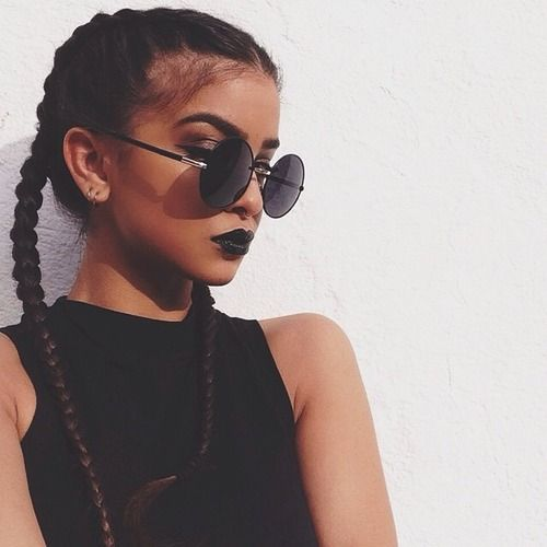 Channel 90s grunge with braids and shades
