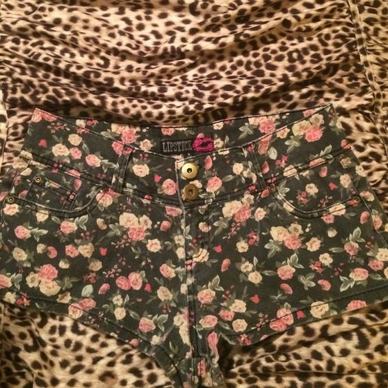 Floral and black shorts size 9 Gently used shorts. Lipstick brand size 9 I don't really use them anymore rather someone use them than just sit there. They've been washed and hang dry. Lipstick Shorts Jean Shorts