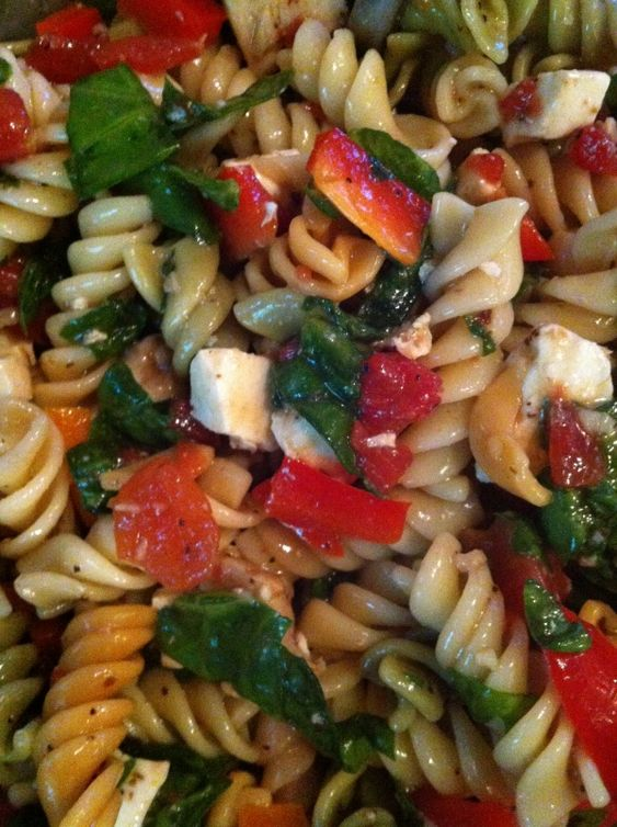 summer pasta salad with mozzarella, chicken, spinach, tomatoes, bell peppers, and balsamic vinaigrette