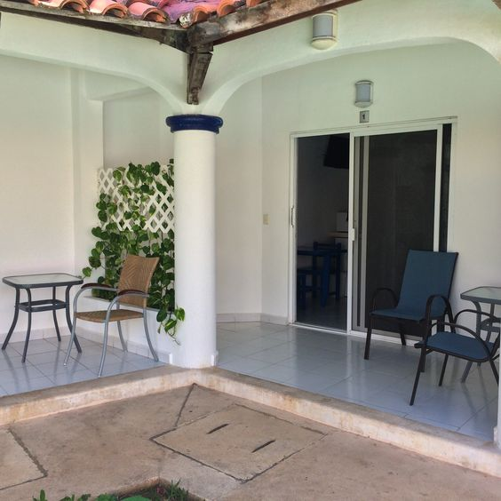 The ground floor rooms surround the private courtyard and pool. Each room has a small patio facing the pool with a table and chairs