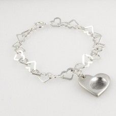 This heart fingerprint, handprint or footprint charm bracelet will make a truly unique present for someone or a gift for yourself, and comes with FREE UK delivery. http://www.katesjewellery.co.uk/personalised-charm-bracelets/heart-fingerprint-charm-bracelet